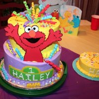 "Surprise! Elmo  8""- 10"" tiers, fondant Elmo, curlicues and handmade confetti. This cake was absolutely the cake from HE!!. I baked the top tier 3..."