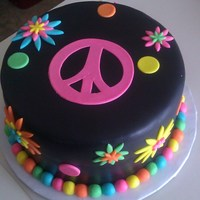 Flower Power Inspired by the party invitation that I designed as well for an 11 year old girl. Love the bright colors on the black fondant.