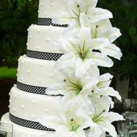 Polka Dot Wedding Cake My most current wedding cake with a polka dot theme finished in white fondant with black and white polka dot ribbon, large lillies, and...
