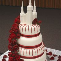 Stacked Wedding Cake With Red Roses This is a chocolate and MM fondant cake I made last spring with fresh red roses. The 'drop' lines are made using red licorice and...