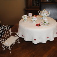 High Tea tea set is not edible, but the table is! white cake, custard filling covered in mmf. thanks for looking
