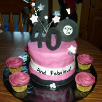 40Th Birthday Accents (stars, 40, record) are fondant. The large cake was basic chocolate cake with buttercream icing, cupcakes were for the adults,...