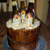 Beer Barrel Completely edible except for the beer labels. Bottles and ice are sugar, bottle caps and wood planks around the cake are fondant. Thanks...