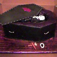 Dracula mmf dracula in a vanilla and carmel cake. buttercrem decorated cake with mmf lid.