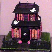 Haunted House White cake in butter cream. royal icing and mmf details.