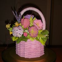"Easter Basket The ""basket"" is made from fondant and the flowers are gumpaste."