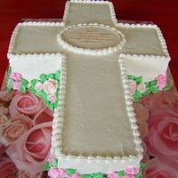 Confirmation Cake Cross cut from a 9 x 13 sheet cake. Chocolate cake iced in white buttercream with royal icing flowers. Flowers were strategically placed to...