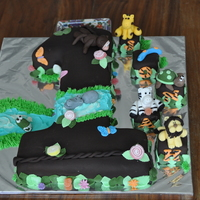 Jungle Theme For A No.1 Cake  I carved the no.1 out of a 6 and 8 inch square cake. Animals are made of fondant, requested by the customer.Covered with chocolate fondant...
