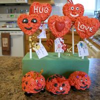 Valentine Day Treats Heart shaped rice crispy treats and love bugs.
