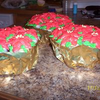 Poinsettia Cupcake Bouquet Cupcake bouquet made into a poinsettia plant. Thank you Yvonne for inspiration and showing were the direction were on CC from cncgirl00.