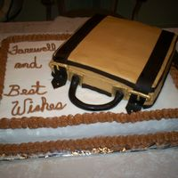 Farewell Cake This is a vanilla cake with all butter buttercream icing. The accents on the suitcase are Satin Ice fondant. This was made rather quickly...