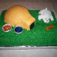 Dog And House This is a white cake with strawberry filing and buttercream icing. Everything is cake and buttercream except the dog bowls and the bone....