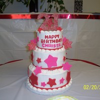 "Christa's Cake 6"" 8"" 10"" cakes stacked. Iced with buttercream and decorated with fondant stars. The numbers are made from chocolate and..."