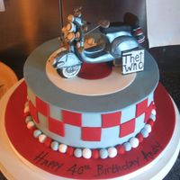 3D Scooter With Mirrors,mod, The Who Scooter bike with mirrors, sitting on an 8 inch cake.