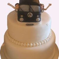 Wedding Cake And Topper Two tier, ivory iced wedding cake , with Campervan, Bride & Groom Topper.