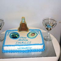 21St Birthday Cake  My customer's wife is celebrating the big 21. The Cognac bottle is pulled sugar with an edible image. The Martini glasses are real and...