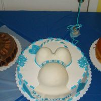 I Made This For A Friends Babyshower this is my first pregnant belly cake, milkyway on the left