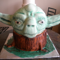 Yoda 3D carved yoda head and tree stump. All cake except yodas ears are rice krispies