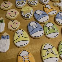 Baby Shower Cookies Lots of cookies for niece's baby shower. Mailed out of state and shewas so surprised. Sugar cookie with RI. Made 5 1/2 dozen.