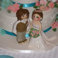 Bride And Groom Gumpaste/fondant bride and groom made for my daughter's wedding.