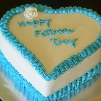 P1020934.jpg   Fathers Day Cake, yellow cake covered with fondant with Vanilla buttercream Icing decorations and a fondant rose.