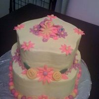 Birthday Cake   Buttercream covered lemon cake with fondant decorations.