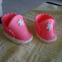 First_Baby_Shoes_2.jpg  My First Baby's Shoes. All Fondant...Not very excited, but I'm sure I will do better next time...one shoe is smaller than the...