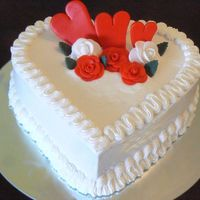 P1020910.jpg   Wedding Aniversary Cake. Chocolate Cake with Almond Buttercream Icing and Fondant Decorations.