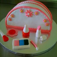 My_First_Makeup_Purse_1.jpg My First Makeup Purse. Fondant covered vanilla cake with fondant decorations.