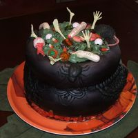 A Halloween Cauldron Cake I spent 3 days on this thing for my moms office. took it today, everyone loved it. cauldron is mmf and decorations are part candy from...