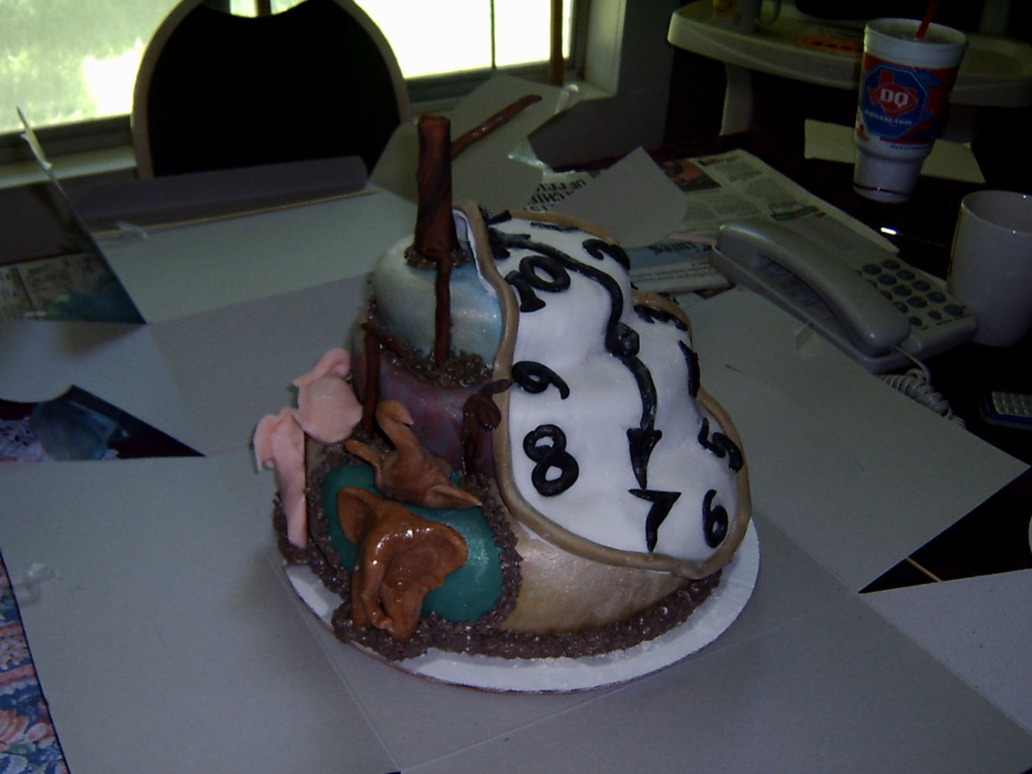 Salvador Dali Interp. I made this cake for my mom's bday. she loves the artist salvador dali it was all fondant and edible.