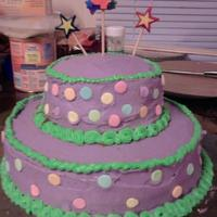 Giant Sprinkle Cake Purple cake with green borders and giant sprinkles.