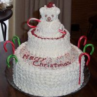 Polar Bear Christmas Cake Two layer chocolate cake with two layer white under polar bear. Decorated with buttercream frosting. This is for a family Christmas party...