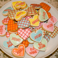 Valentines Hearts   Sugar cookies with royal icing. sanding sugar and dragees for the accents.
