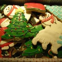 Christmas Cookies  Sugar cookies with royal icing. A medley of cookies..snowmen, santas, penguins, igloos, polar bears, christmas bunnies, lightbulbs,...
