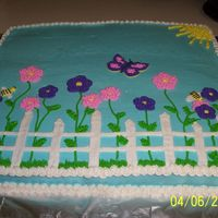 Spring Cake This is two 12x18 cakes together. This was the most difficult cake I've ever made. It kept cracking so I had to make one of the cakes...