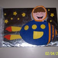 Outer Space Cake This was done using the football pan and a one layer 6in. pan. Most of the decorations are done in fondant. This was for a Boy Scout...
