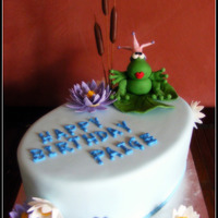 Paige Chocolate mud cake with chocolate ganache and blue fondant, frog/flowers of fondant.