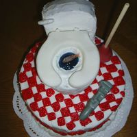 "Retirement Plumber Cake 8"" round buttercream with fondant toilet, and gum drop fish and chocolatetools."
