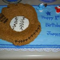 First Birthday Cake 1/2 sheet cake with baseball mitt, done in buttercream. Took liberty with Cookie monster and Elmo finger puppets by adding a mitt and ball...