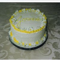 Daisy Birthday Cake   Lemon Butter Cake with Lemon Curd and IMBC. Iced in IMBC, with gumpaste daisys.