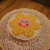 Part Three smash cake. The face on this is a duplicate of the little girls favorite plush flower.