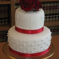 Simplicity Wedding cake after a civil ceremony at the courthouse. Ivory fondant with fondant pearls dusted with super pearl dust. Purchased ribbon and...