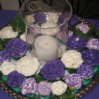 Cupcake Centerpiece   Buttercream piped on lemon cupcakes for a potluck luncheon. I was afraid that the candle might melt the frosting, but all went well.