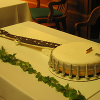 Banjo  This is a life-size banjo cake without strings. I used fondant everywhere except the frets (marking where the player puts her fingers),...