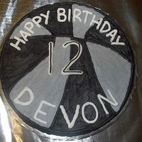 Basketball Birthday Cookie  Done for a friend's son who wanted a basketball cookie using Spurs colors. He wanted silver (not gray), so I added some crushed up...