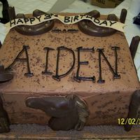 Cowboy Birthday Cake  Made this one for my son's 3rd birthday. Chocolate cake with chocolate buttercream. Chocolate molds for the horseshoes, horse, boots...