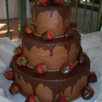 3-Tiered Chocolate Cake With Dipped Strawberries  Made this for a 50th wedding anniversary. Triple Chocolate Fudge Cake with Chocolate Buttercream and that Betty Crocker Pour and Frost...