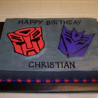 "Transformers - Autobot & Decepticon Birthday  For the son of a friend of mine for work. He loves the Transformers so I did a half chocolate, half vanilla sheet cake (10x15x3"") with..."