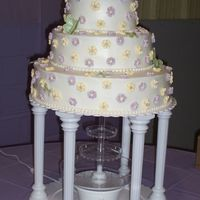 Butterfly Wedding Cake  My friend found this cake done in all white in a wilton book, her colors were lavender and yellow and her theme was butterflies. I made the...